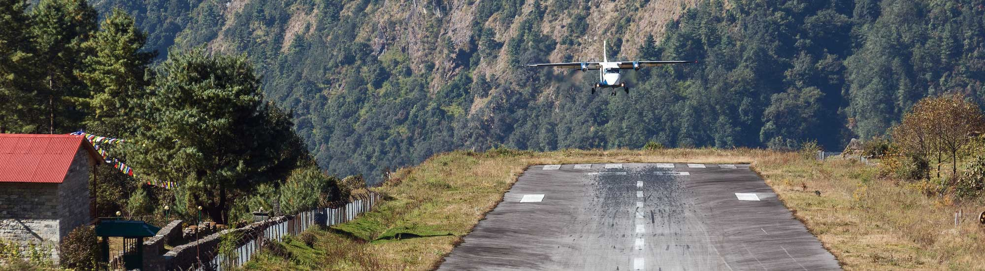Twin Otter aircraft landing on remote airstrip
